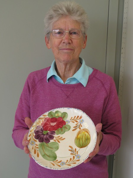 Joan holding plate
