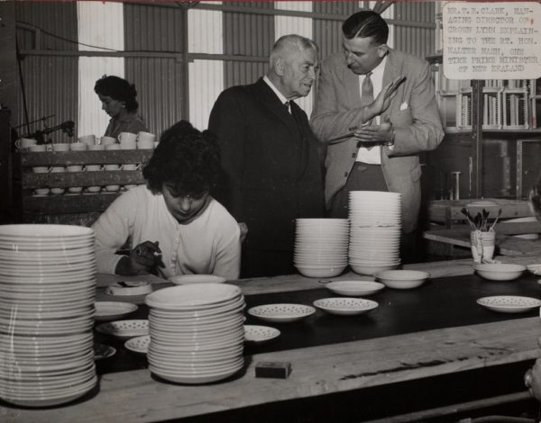 Managing director of Crown Lynn, Tom Clark, explaining to R.T Hon. Walter Nash Prime Minister, whilst Freda Desai paints saucers.
